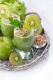 Healthy green smoothie with sprouts on a white wooden table Royalty Free Stock Photos