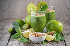 Healthy green smoothie with sprouts on a wooden table Royalty Free Stock Photography