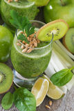 Healthy green smoothie with sprouts on a wooden table, vertical Royalty Free Stock Photos