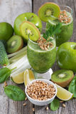 healthy green smoothie with sprouts on a wooden table, vertical Stock Image