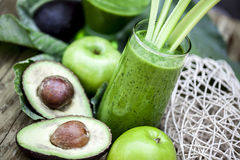 Healthy green smoothies. Healthy green smoothies with fresh fruits and vegetables Royalty Free Stock Image