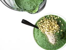 Healthy green smoothy for breakfast, blender, healthy lifestyle, diet and nutrition concept royalty free stock photography