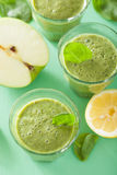 Healthy green spinach smoothie with apple lemon Royalty Free Stock Photo