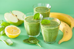 Healthy green spinach smoothie with apple lemon banana Stock Photo