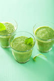 Healthy green spinach smoothie in glass Royalty Free Stock Image