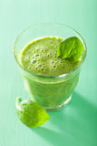 Healthy green spinach smoothie in glass Stock Photos