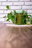 Healthy green spinach smoothie in jar on wooden table, selective focus. Royalty Free Stock Images