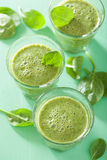 Healthy green spinach smoothie with leaves Royalty Free Stock Photo