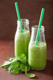 Healthy green spinach smoothie with lemon orange Stock Photos
