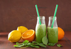 Healthy green spinach smoothie with lemon orange Stock Image