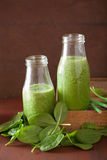 Healthy green spinach smoothie with lemon orange Stock Photo