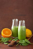 Healthy green spinach smoothie with lemon orange Stock Photography