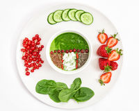 Healthy green spinach smoothie strawberry chia linseeds Royalty Free Stock Images
