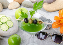 Healthy green vegetables cocktail on a beach environment Stock Photo
