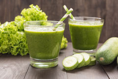 Healthy green vegetables and green fruit smoothie on rustic wood Stock Photos