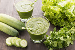 Healthy green vegetables smoothie on rustic wood table Royalty Free Stock Photo