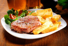 Healthy Grilled Beef and Potato Fries on Plate Stock Photo