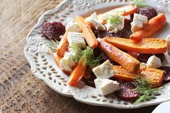 Healthy grilled beet, carrots salad with cheese feta, fennel , top view royalty free stock photos