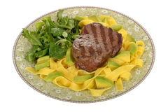 Healthy Grilled Fillet Steak with Pasta and Green Salad Meal Stock Image