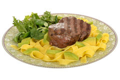 Healthy Grilled Fillet Steak with Pasta and Green Salad Meal. On a plate isolated white background Royalty Free Stock Photos