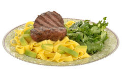 Healthy Grilled Fillet Steak with Pasta and Green Salad Meal. On a plate isolated white background Stock Image