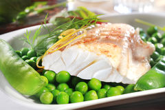 Healthy grilled fish steak with peas Royalty Free Stock Photography