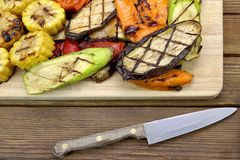 Healthy Grilled Food. BBQ Vegetables Assortment On The Board. Healthy Grilled Food. Hot BBQ Sliced Vegetables  Assortment On The Cutting Board Royalty Free Stock Image