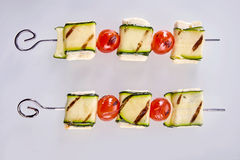 Healthy grilled haloumi cheese and tomato kebabs Royalty Free Stock Photos