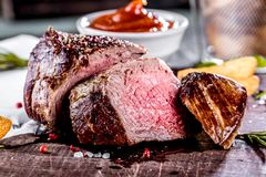 Healthy grilled medium-rare beef steak and vegetables with roasted Potatoes royalty free stock photo