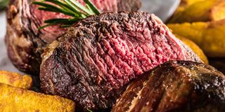 Healthy grilled medium-rare beef steak and vegetables with roasted Potatoes. Healthy grilled medium-rare beef steak and vegetables roasted Potatoes stock photography