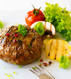 Grilled patty and vegetable. Healthy grilled patty and vegetable in a close up shot Royalty Free Stock Photos