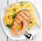 Healthy grilled salmon steak on linguine Royalty Free Stock Photography