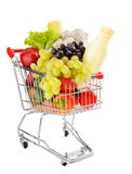 Healthy groceries shopping. Shopping trolley full of fresh groceries isolated on a white background Stock Photography