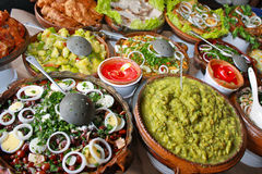 Healthy Guatemalan Food. Typical guatemalan food (e.g. guacamole), displayed in traditional earthen plates Royalty Free Stock Photos