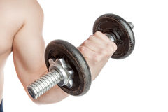 Healthy guy with a dumbbell. Doing biceps. Stock Photo