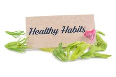 Healthy Habit on card. With dried flower isolated on white background stock images