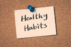 Healthy Habits. Concept reminder message on a cork board Royalty Free Stock Image