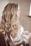 Healthy hair. Curly long hairstyle. Back view of Blond hairs. ha Stock Photography