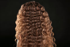 Healthy hair. Curly long hairstyle. Back view of Brown hairs. ha Stock Photo