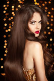 Healthy hair. Makeup. Beautiful brunette girl with long wavy hai Royalty Free Stock Photography