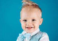 Healthy haircare tips for kids. Boy child with stylish blond hair. Little child with messy top haircut. Little child. With short haircut. Haircare products royalty free stock photos