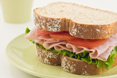 Healthy Ham sandwich. With lettuce and tomato on whole wheat bread Stock Images