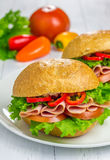 Healthy ham sandwiches with vegetables on background. Healthy ham sandwiches closeup with vegetables on background Royalty Free Stock Images