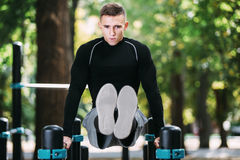 Healthy handsome active man with fit muscular body doing workout exercises Royalty Free Stock Images
