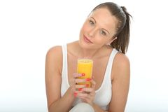 Healthy Happy Fit Attractive Young Woman Holding a Glass Of Fresh Orange Juice Royalty Free Stock Photos