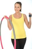 Healthy Happy Fit Young Woman Holding a Dumb Bell and Fitness Hula Hoop Royalty Free Stock Photos