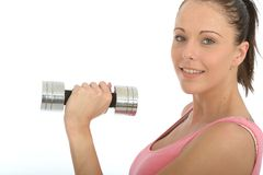 Healthy Happy Fit Young Woman Holding Dumb Bell Weight. A DSLR royalty free image, a healthy happy fit young woman, side on to camera, looking at camera smiling Royalty Free Stock Images