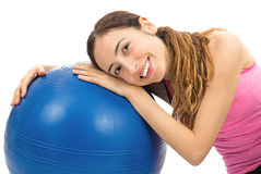Healthy happy fitness woman sitting next to an exercise ball Royalty Free Stock Photos