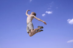 Healthy happy man jumping Royalty Free Stock Images