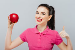 Healthy Happy, natural organic raw fresh food concept portrait of attractive girl of the holding apple in her hands over royalty free stock images